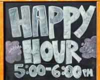 Sinal para o happy hour Fotografia de Stock
