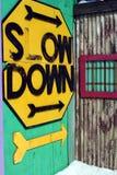 Sinal rústico do Slow Down Fotografia de Stock