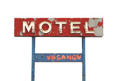 Sinal velho do motel isolado. fotografia de stock royalty free