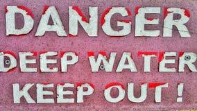 Sinal velho do perigo Imagem de Stock