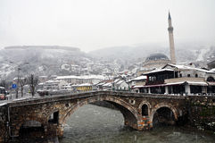 Sinan Pasha mosque and a stone bridge, Prizren Kosovo. Sinan Pasha mosque and a stone bridge pictured as cold weather returned to Prizren bringing with it Stock Photo