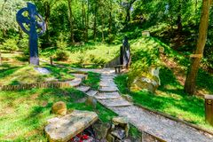 Sinca Veche, Fagaras, Romania - Path through the woods to the an. Cient temple cave Royalty Free Stock Photo