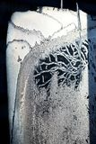 Sincelos na janela congelada Imagem de Stock Royalty Free