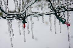 Sincelos que penduram das luzes de Natal imagens de stock royalty free
