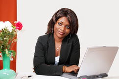 Sincere african woman in office Royalty Free Stock Photos