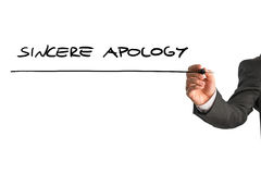 Sincere apology. Closeup of male hand writing Sincere apology on white virtual screen Royalty Free Stock Image