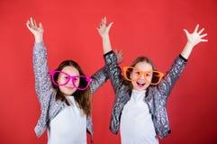 Sincere cheerful kids share happiness and love. Girls funny big eyeglasses cheerful smile. Birthday party. Happy. Childhood. Joyful and cheerful. Sisterhood stock photos