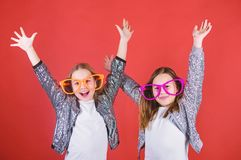 Sincere cheerful kids share happiness and love. Girls funny big eyeglasses cheerful smile. Birthday party. Happy. Childhood. Joyful and cheerful. Sisterhood royalty free stock image