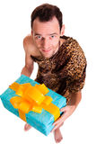 Sincere gift from wild funny man royalty free stock photography