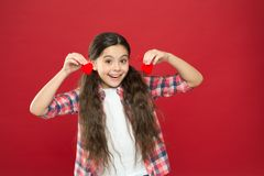 Sincere love. Be my valentine. Family love. Girl cute child with hearts. Kid girl with long hair red background. Celebrate valentines day. Playful baby hold stock photography