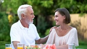 Sincere talk of father with grown up daughter, emotional conversation, advising. Stock photo royalty free stock photo