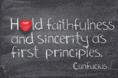 Sincerity as first Confucius. Hold faithfulness and sincerity as first principles - ancient Chinese philosopher Confucius concept quote written on chalkboard royalty free stock photos