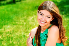 Sincerity. Portrait of romantic young woman with beautiful smile outdoors stock photography