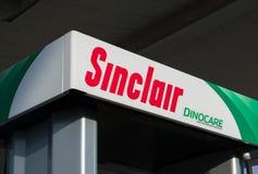 Sinclair Gas Station Pump en Embleem Stock Foto