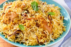 Sindhi nonvegetarian Chicken Biryani. Biryani, biriani, or beriani is a set of rice-based foods made with spices, rice usually basmati and meat, fish, eggs or royalty free stock image