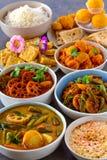 Sindhi traditional wedding platter vegetarian main course. North Indian veg mains consisting of sindhi kadhi or stew,boondi matha or raita,stuffed tinde or ash royalty free stock photography