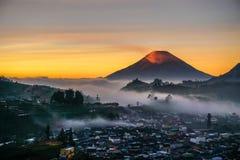 Sunrise. Sindoro mountain with orange blanket, Yogyakarta, Indonesia Royalty Free Stock Images