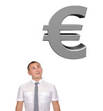 Sinessman looking at euro Royalty Free Stock Images