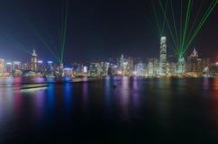 Sinfonia da luz no porto de Victoria na noite em Hong Kong Fotografia de Stock Royalty Free