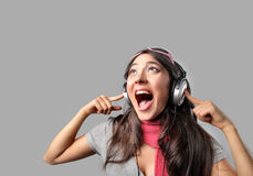 Sing. Portrait of Girl with headphones singing Stock Photos