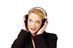 Sing. Woman with headphones sings to the music in her headphones. On white background Royalty Free Stock Photo