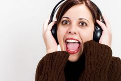 Sing along 2. Girl with headphones, happy and singing Royalty Free Stock Images