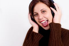 Sing along. Girl with headphones, happy and singing Stock Image