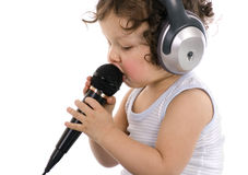 Sing baby. Sing baby with headphone and microphone,isolated on a white background stock photo