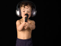 Sing baby. Sing baby with headphone and microphone,isolated on a black background stock images