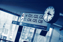 Sing board and clock at airport Stock Image