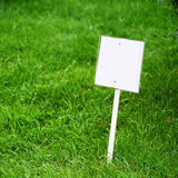 Sing board on grass Stock Images