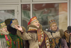 Sing a folk song. PODOLSK, RUSSIA - FEB 26: Unidentified people of folk collective Veterans on Russian religious and folk holiday Maslenitsa on a square in stock photography