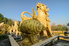 Sing ha statue ancient object in Thailand. Sing or lion in lambs Thai styled Royalty Free Stock Image
