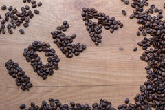 Sing of Idea concept drawn among roasted brown beans of coffee Royalty Free Stock Photography