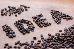 Sing of Idea concept drawn among roasted brown coffee beans Royalty Free Stock Images