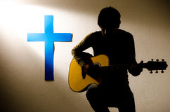 Sing for Jesus. Man worship Jesus in studio Royalty Free Stock Image