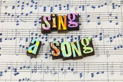 Sing song me musical letterpress songwriter happy joy type. Sing song me musical letterpress songwriter happy joy typography font music sheet singer happiness stock images