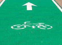 Sing white bike on bike lanes and arrow. Sing white bike on bike lanes and arrow go straight Stock Photos