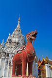 Singa statue at the door, Wat Phrathat Hariphunchai Royalty Free Stock Photo