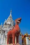 Singa statue at the door, Wat Phrathat Hariphunchai Royalty Free Stock Photo