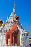 Singa statue at the door, Wat Phrathat Hariphunchai Royalty Free Stock Photos