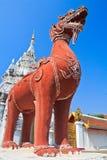 Singa statue at the door, Wat Phrathat Hariphunchai Royalty Free Stock Photography