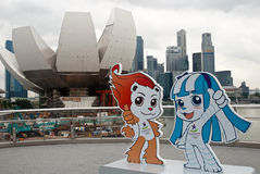 SINGAPORE 2010 YOUTH OLYMPIC GAMES: mascots. SINGAPORE 2010 YOUTH OLYMPIC GAMES, AUGUST 14th: two olympic mascots with singapore skyline on the background Stock Photos