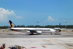 Singapore Airline on taxiway. SINGAPORE - MARCH 28: An aircraft parking at Changi airport on March 28, 2014 in Singapore. Changi Airport 42 million passengers a Royalty Free Stock Photo