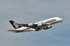 Singapore Airlines Airbus A380 climbs in the sky. Royalty Free Stock Photography