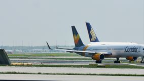Singapore Airlines Airbus A380 and Condor planes in Frankfurt Airport, FRA stock video footage