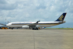 Singapore Airlines Airbus A330. MALE, MALDIVES - AUGUST 31, 2014: A Singapore Airlines Airbus A330 at Ibrahim Nasir International Airport. Singapore Airlines is Royalty Free Stock Photos