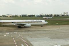 Singapore Airlines aterrou no aeroporto de Ho Chi Minh Imagem de Stock