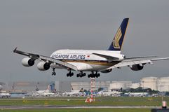 Singapore Airlines Super Jumbo. Singapore Airlines Airbus A380 about to land in Frankfurt. Singapore is one of the Super Jumbo early adopters and currently Stock Photo