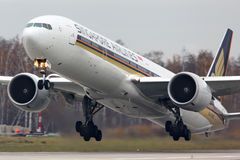 Singapore Airlines Boeing 777-300 9V-SWR taking off at Domodedovo international airport. Royalty Free Stock Photos